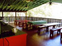 Image of Kitchen and Treehouse Dining Deck